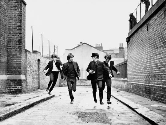 Paul McCartney, left, George Harrison, Ringo Starr,