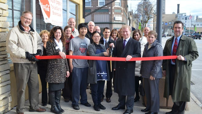 The Tokyo Sushi and Steak House became part of downtown Manitowoc's business and cultural corridor during a ribbon-cutting ceremony earlier this month. Owner Cynthia Yue and Manitowoc Mayor Justin Nickels (center) did the honors while surrounded by   restaurant employees, members of The Chamber of Manitowoc County's Board of Directors and Chamber Ambassadors.