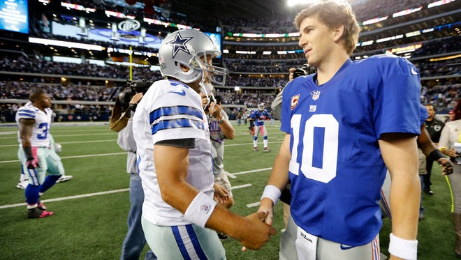 """The Giants' Eli Manning, right, shown with  Dallas QB Tony Romo, says the only thing that sticks out about last year's season opener against the Cowboys is """"we lost.''"""