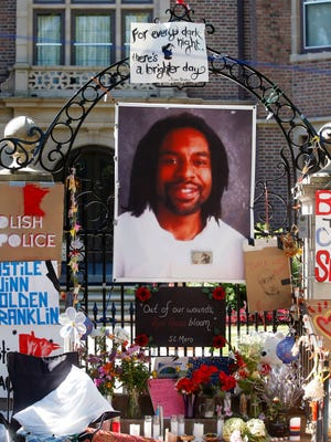 FILE - In this July 25, 2016, file photo, a memorial including a photo of Philando Castile adorns the gate to the governor's residence where protesters continue to demonstrate in St. Paul, Minn., against the July 6 shooting death of Castile by St. Anthony police officer Jeronimo Yanez during a traffic stop in Falcon Heights, Minn. Prosecutors announced Wednesday, Nov. 16, 2016, that Yanez has been charged with second-degree manslaughter in the killing. (AP Photo/Jim Mone, File)