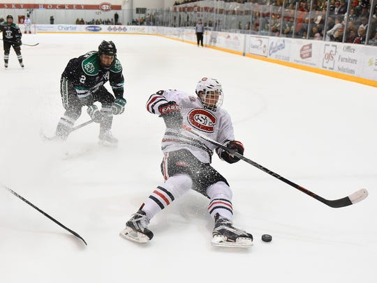 St. Cloud State's Daniel Tedesco chases the puck in