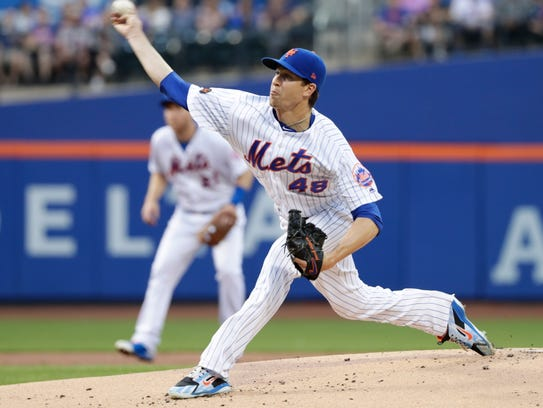 New York Mets' Jacob deGrom delivers a pitch during