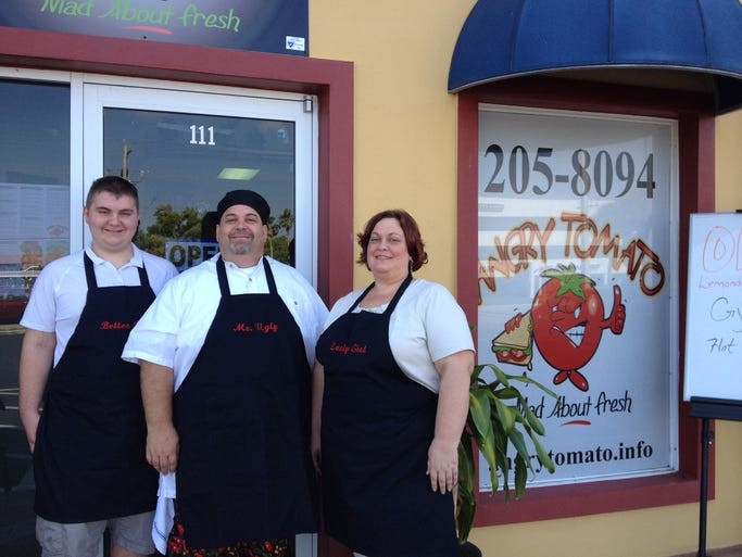 David Truman, Brandon Cramer, and Jennifer Cramer all work together at the family's new eatery, The Angry Tomato on Friday.