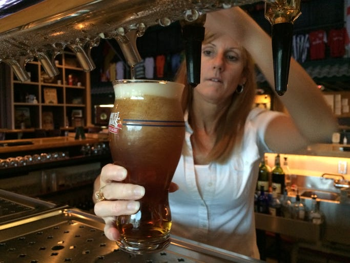 Owner Jeannine Williams pours a pint of Yuengling at the 2-year-old Dublin Ale House Pub in Cape Coral.