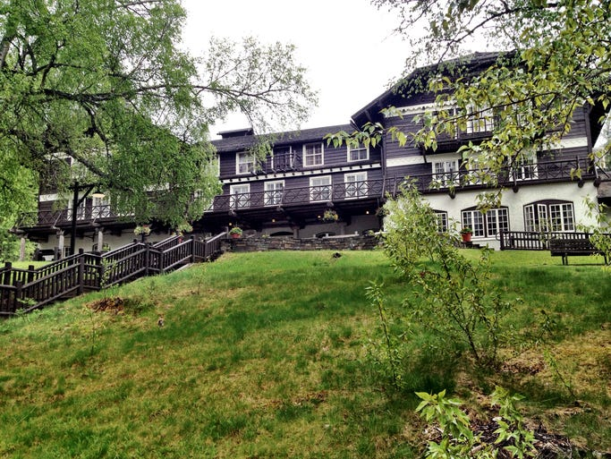 The side of Lake McDonald Lodge that faces the lake shore was designed to be the front of the building, since visitors arrived by boat before the Going-to-the-Sun Road was built.