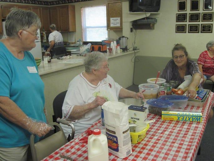 The Clarkridge Volunteer Fire Department Auxiliary Aug. 20 Pie-athon. Shown are (from left) Helen Chandler, Pauline Redmon and  JoAnn McFarland.