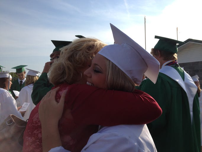 Greenbrier High School senior Aymie Burnett gets a hug from her aunt Kathy Burnett before the graduation ceremonies begin on Monday, May 18, 2014.