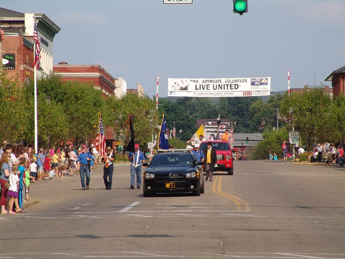 """The 2014 Coshocton Canal Festival Grande Parade was held Saturday evening. More than 105 entries made their way along the parade route. This year's festival and parade theme is """"Reflections of Our Heritage."""""""