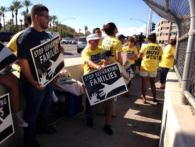 Members of Promise Arizona, a non-profit group that aims to improve the lives of immigrant families and push for new legislation surrounding the issue, protest U.S. deportations.