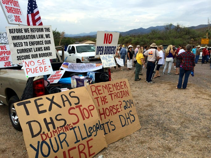 More than a hundred people came to protest the buses bringing unaccompanied minors to an Oracle boy's ranch.