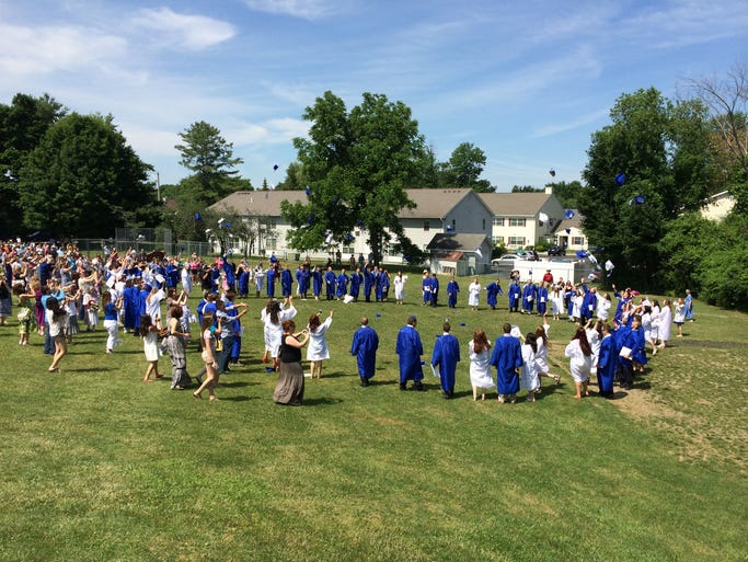 Millbrook High School held its 2014 commencement ceremony on the West Lawn at the Alden Place Elementary School Saturday morning.