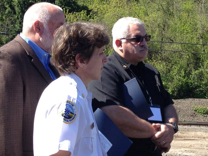 Portland Fire Chief Erin Janssens and Salem Fire Chief Mike Niblock learn about crude oil rail car safety at a briefing in Portland April 29.
