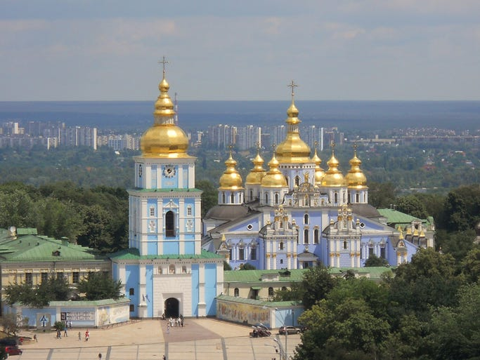 The golden domes of St. Michaels Cathedral                                                          sparkle in                                                          the skyli