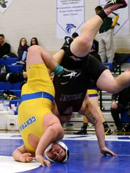 Sussex Central's Victor Cruz is upended as he wrestles