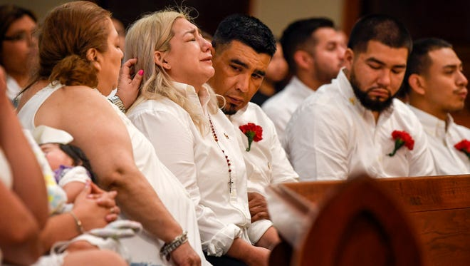 Grandmother Adele Cardenas, left, comforts daughter Tricia with husband Joe Perez Sr., and their son Christian Perez during the funeral of Joe Rene Perez Jr., the youngest victim of the Waffle House killings, at the St. Anthony's Marie de Claret Church, in Kyle, Texas., Tuesday, May 1, 2018.