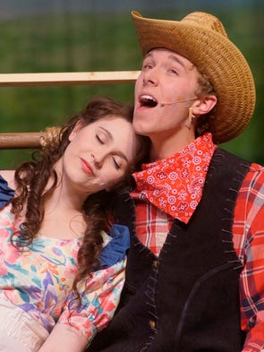"""Curley (Ryan Wagner) sings """"The Surrey With the Fringe"""