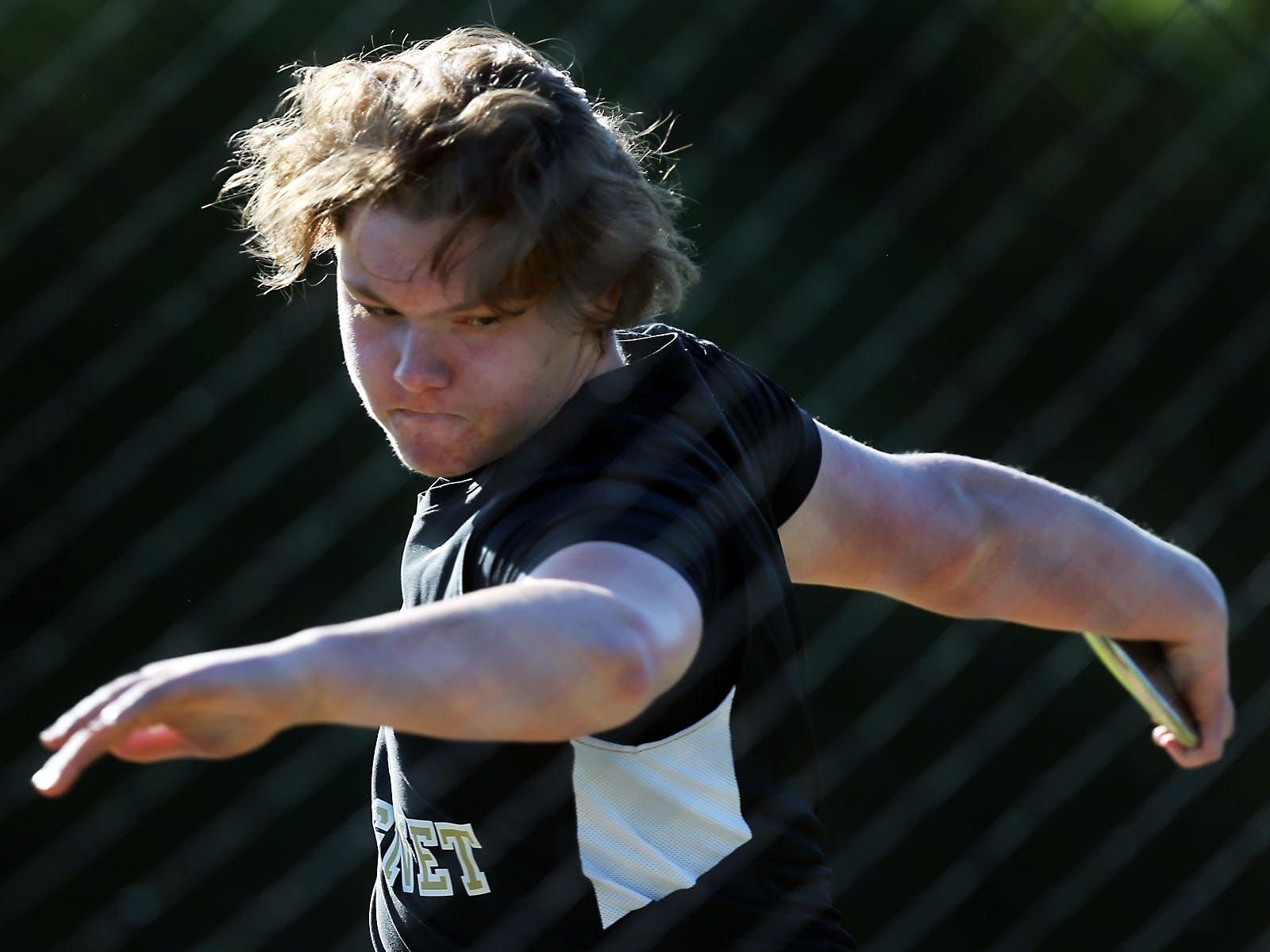 Central Magnet's Hunter Meany competes in the discus on Monday at Riverdale.
