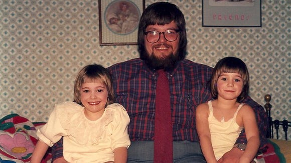 Abbey, her dad Jeff and twin sister Sarah at about 6 in their childhood bedroom.