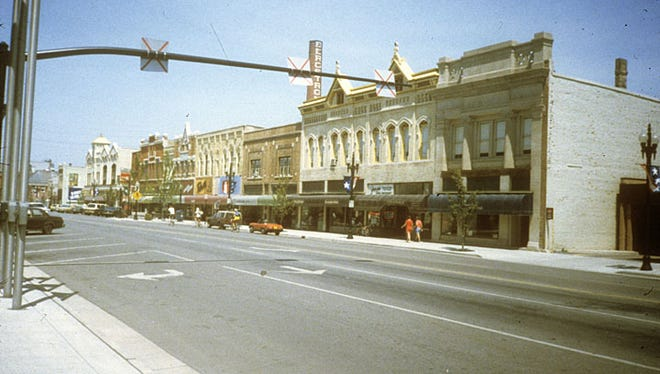This photograph circa 1985 shows downtown Neenah looking west from the corner of Wisconsin Avenue and Commercial Street.