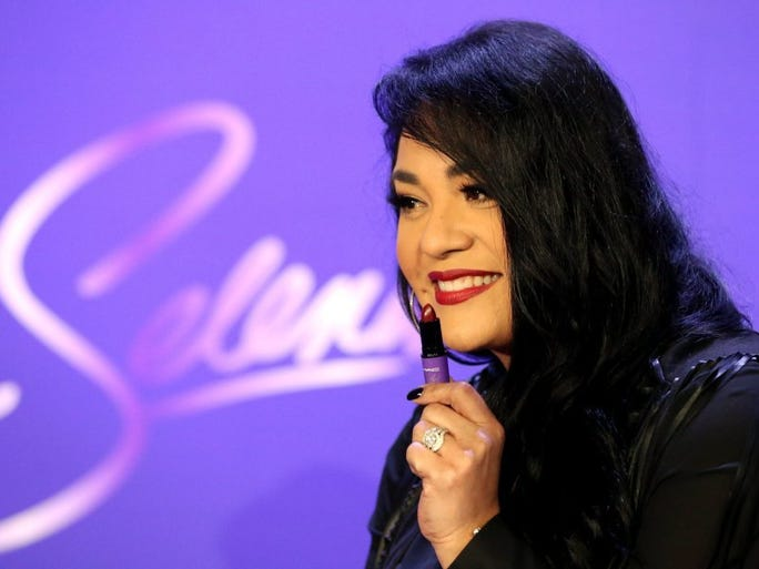 GABE HERNANDEZ/CALLER-TIMES Suzette Quintanilla Arriaga displays her favorite shade of lipstick while talking to media during a news conference for the MAC Selena makeup collection launch Thursday, Sept. 29, 2016, at the American Bank Center in Corpus Christi.
