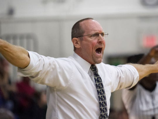 Fort Myers coach Jimmy Roberts calls a timeout in the final minutes against Lakewood Ranch in the girls regional basketball finals on Saturday, February 14, 2015, at Fort Myers High School.