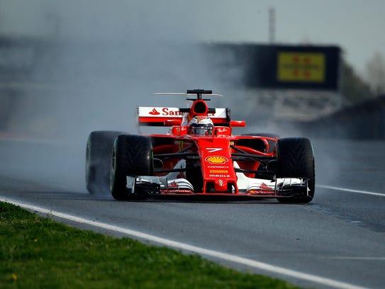 Ferrari driver Kimi Raikkonen steers his car through