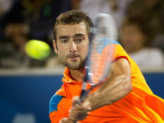 Marin Cilic, of Croatia, returns the ball to Kevin Anderson during the Delray Beach Open tennis tournament, Sunday, Feb. 23, 2014, in Delray Beach, Fla. Cilic won 7-6 (6), 6-7 (7), 6-4.  (AP Photo/J Pat Carter)