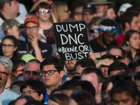 Supporters listen to Bernie Sanders during a rally