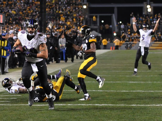 Baltimore Ravens tight end Crockett Gillmore (80) heads for the end zone ad a touchdown in the fourth quarter of an NFL wildcard playoff football game against the Pittsburgh Steelers, Saturday, Jan. 3, 2015, in Pittsburgh. (AP Photo/Don Wright)