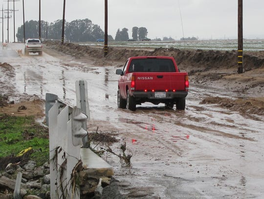 An image of a flooded Alisal Road heading out into unincorporated Monterey County.
