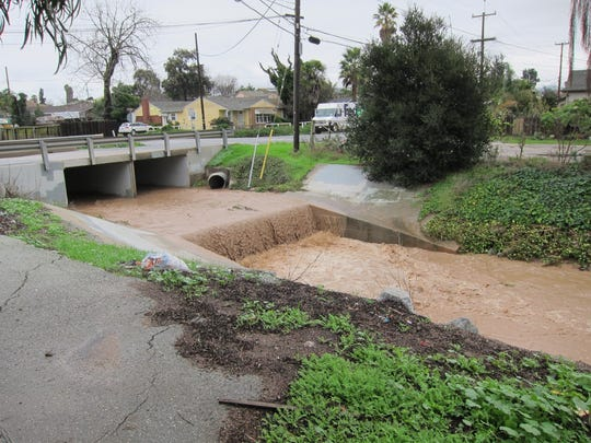 An overwhelmed Santa Rita Creek in Salinas.