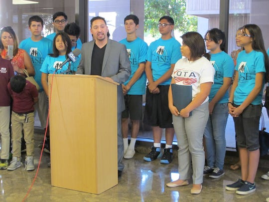 Rep. Martin Quezada, D-Phoenix, speaks at a demonstration Tuesday, May 19, 2015, at the State Capitol in support of deferred action programs.