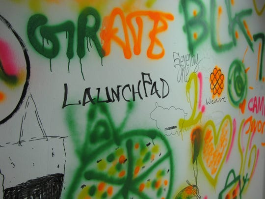 A wall full of graffiti at LaunchPad @ One North, a
