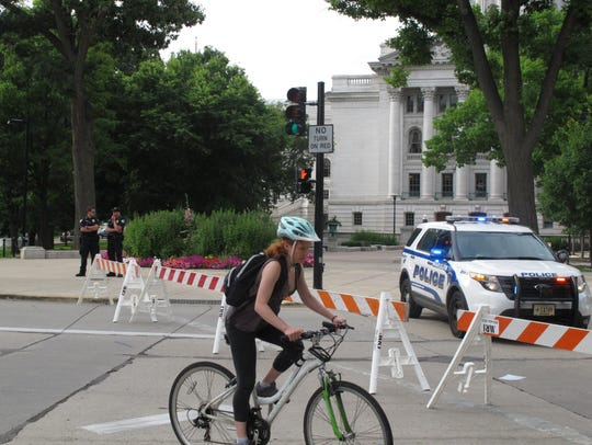 A bicyclist is diverted from the Capitol after a bomb
