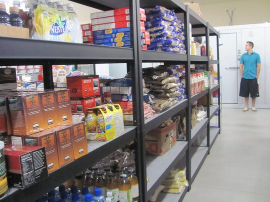 A variety of food items including coffee, pasta and breakfast cereals line shelves at the Switchpoint food pantry Wednesday.