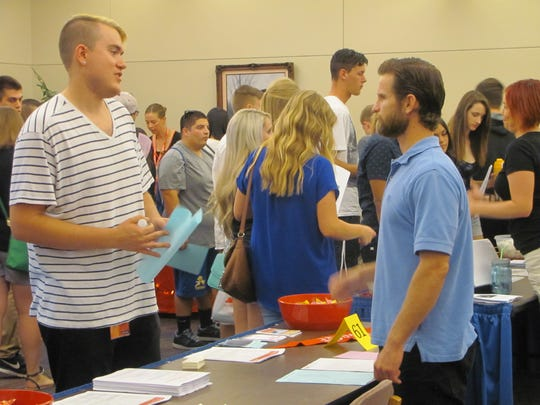 Incoming Dixie State University students visit with school department and off-campus business representatives Saturday during an Academic Resource Fair.