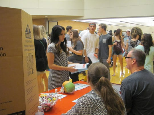 Students review their options for information and a few treats to eat as well during a recent Dixie State University's Academic Resource Fair for incoming freshmen.