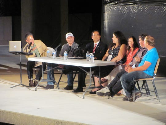 """Participants in a moderated panel including former Fundamentalist Church of Jesus Christ of Latter Day Saints members, private investigator Sam Brower, second from left, and Utah Attorney General Sean Reyes, third from left, answer questions Friday night following the screening of """"Prophet's Prey"""" in Springdale."""