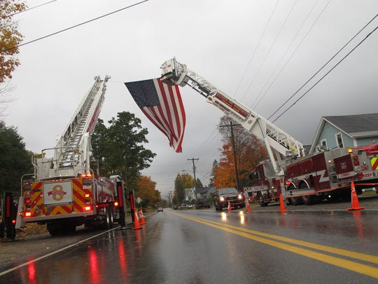Ladder trucks from Essex and Williston fire departments