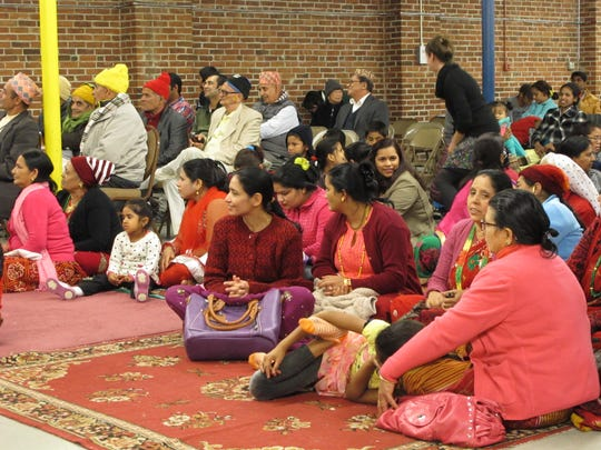 Nepali Hindus gather Saturday to celebrate the Dashain festival at the former St. Joseph School on Allen Street in Burlington.