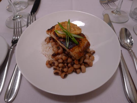 Atlas Eats will serve a New Orleans menu for the holiday weekend, including blackened red fish over stewed black eyed peas and rice.