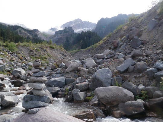 A crossing on the Timberline Trail is seen at the Muddy Fork basin below the Sandy Glacier.