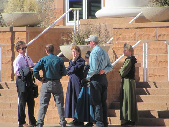 Attorney Jon Williams, left, meets with supporters of Fundamentalist Church of Jesus Christ of Latter Day Saints members charged with conspiracy in a federal food stamps fraud case in this February file photo at St. George's district courthouse. Six of the 11 FLDS defendants charged in the case entered plea agreements Wednesday.