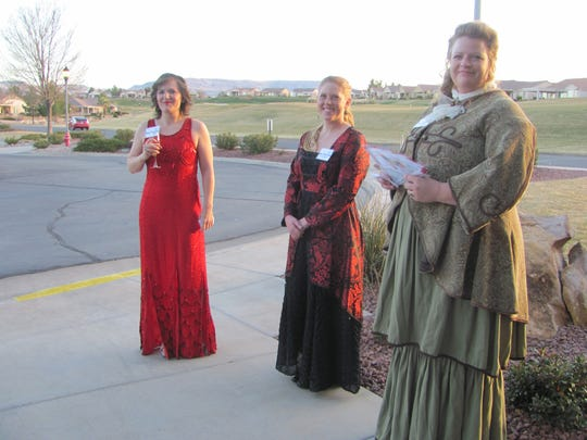 From left, Ambree Hall, Kenzi Sullivan and Megan Thacker greet guests at the annual Fire and Ice gala Friday, dressed as Helen Hayes, Eleanor Roosevelt and Abigail Adams, respectively.