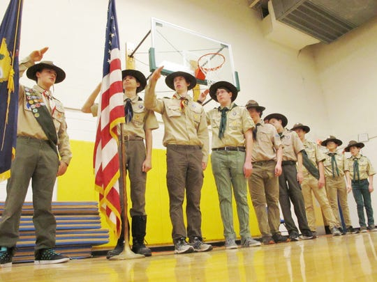 Boy Scouts from Troop 904 salute at the end of the Pledge of Allegiance on Monday night at Shelburne's pre-Town Meeting Day meeting.