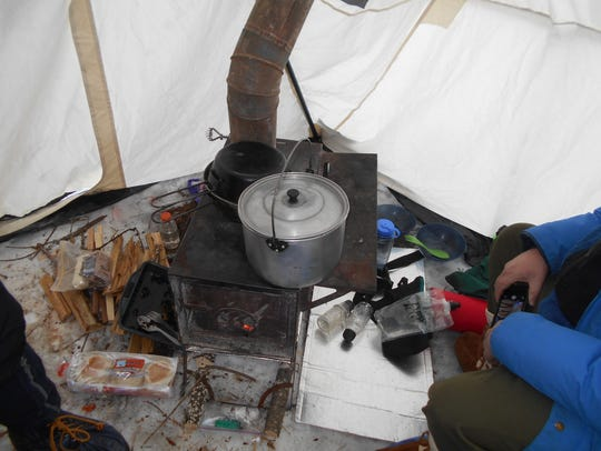 At left is the tent door. The wood stove heated the