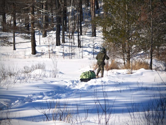 Dick Shank of St. Paul pulls his sled through the Boundary