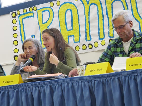 Huntington Selectboard Chairwoman Dori Barton takes a question from the floor Tuesday during Town Meeting Day. Also pictured: Selectboard members Nancy Stoddard and Roman Livak.