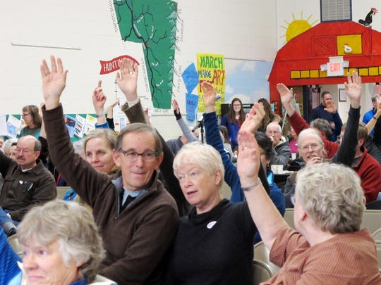 A hand-vote from the floor at Huntington's Town Meeting Day in 2016.