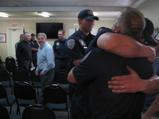 Washington City firefighters congratulate Capt. Matt